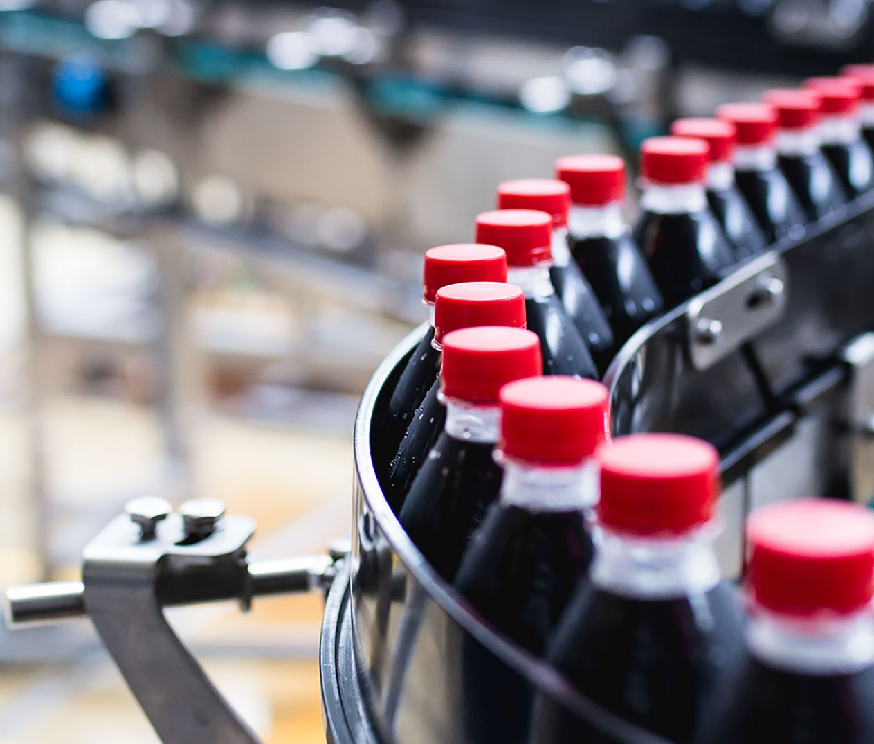 Limino OEE Enhancement image of beverage bottles in bottling plant
